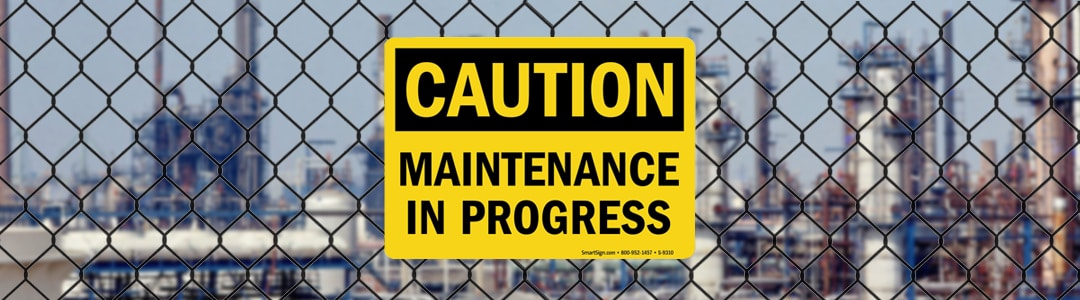 maintenance sign on fence oil refinery turnaround banner